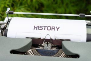 """Typewriter with a sheet of paper in saying """"History"""""""