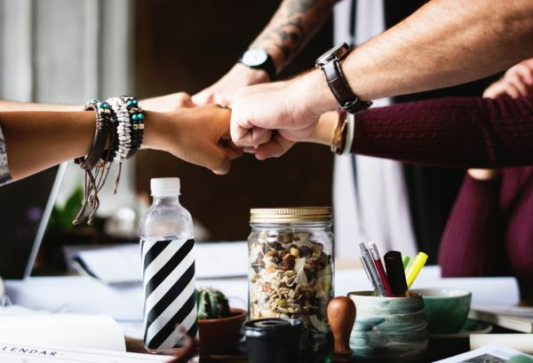 Image of hands joining together in team work theme